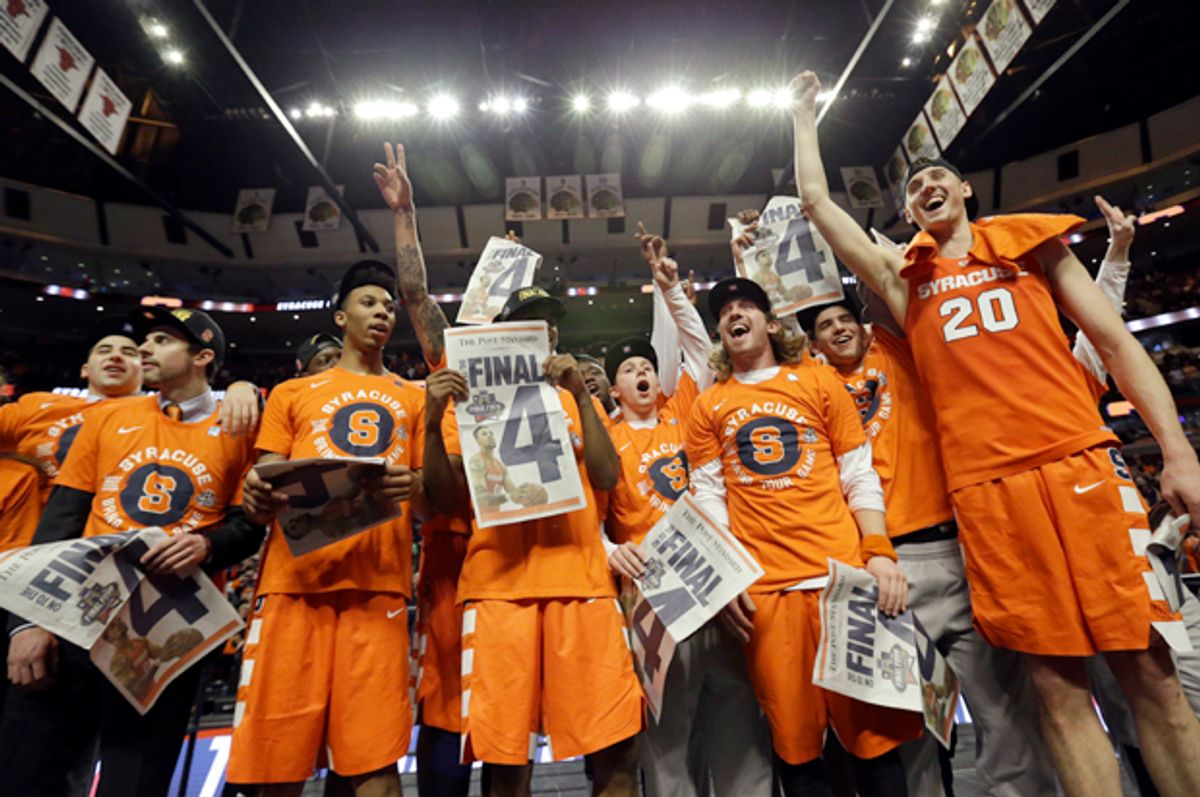 Syracuse players celebrate after beating Virginia in the regional finals of the NCAA Tournament, March 27, 2016, in Chicago.   (AP/Nam Y. Huh)