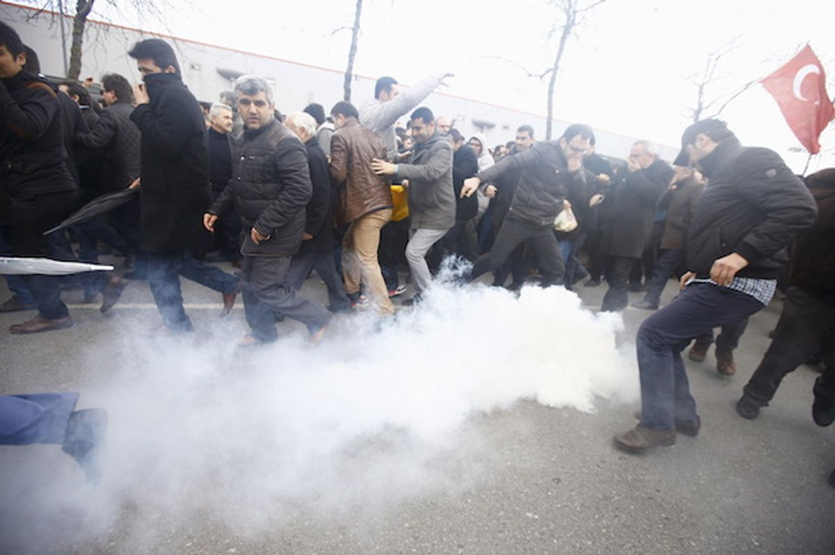 Turkish riot police use tear gas to disperse protesting employees and supporters of the Zaman newspaper, which the government violently seized control of, at its office in Istanbul, on March 5, 2016  (Reuters/Osman Orsal)
