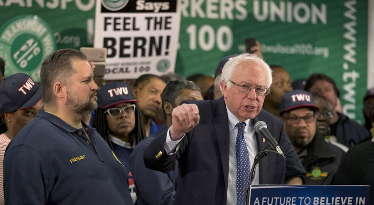 TWU Local 100 President John Samuelsen listens at left as Democratic presidential candidate, Sen. Bernie Sanders, I-Vt. speaks after being endorsed by TWU Local 100, Wednesday, April 13, 2016, in the Brooklyn borough of New York.  (AP Photo/Mary Altaffer)