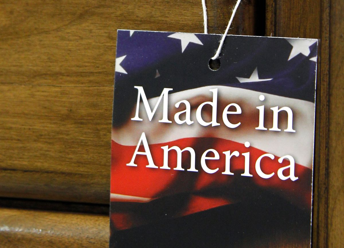 """In this March 16, 2012 file photo, a """"Made in America"""" tag hangs on a chest of drawers at a furniture factory in Lincolnton, N.C. The vast majority of Americans say they prefer lower prices instead of paying a premium for items labeled """"Made in the U.S.A.,"""" even if it means those cheaper items are made abroad, according to an Associated Press-GfK poll.  () (AP Photo/Bob Leverone, File)"""