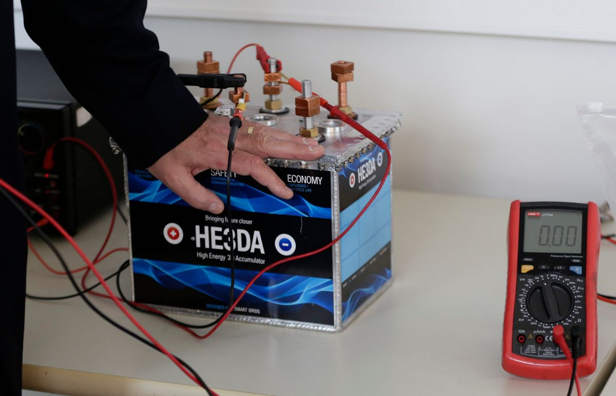 In this picture taken on Wednesday, March 9, 2016, Jan Prochazka, the president of Prague based He3Da company, presents his battery in Prague, Czech Republic. In the global race to create more efficient and long-lasting batteries, some are betting on nanotechnology - the use of minuscule parts - as the most likely to yield a breakthrough. Improving batteries' performance is key to the development and success of many much-hyped technologies, from solar and wind energy to electric cars. Research into how to achieve that has followed several avenues, from using different materials than the existing lithium-ion batteries to changing the internal structure of batteries using nanoparticles - parts so small they are invisible to the naked eye. (AP Photo/Petr David Josek) (AP)