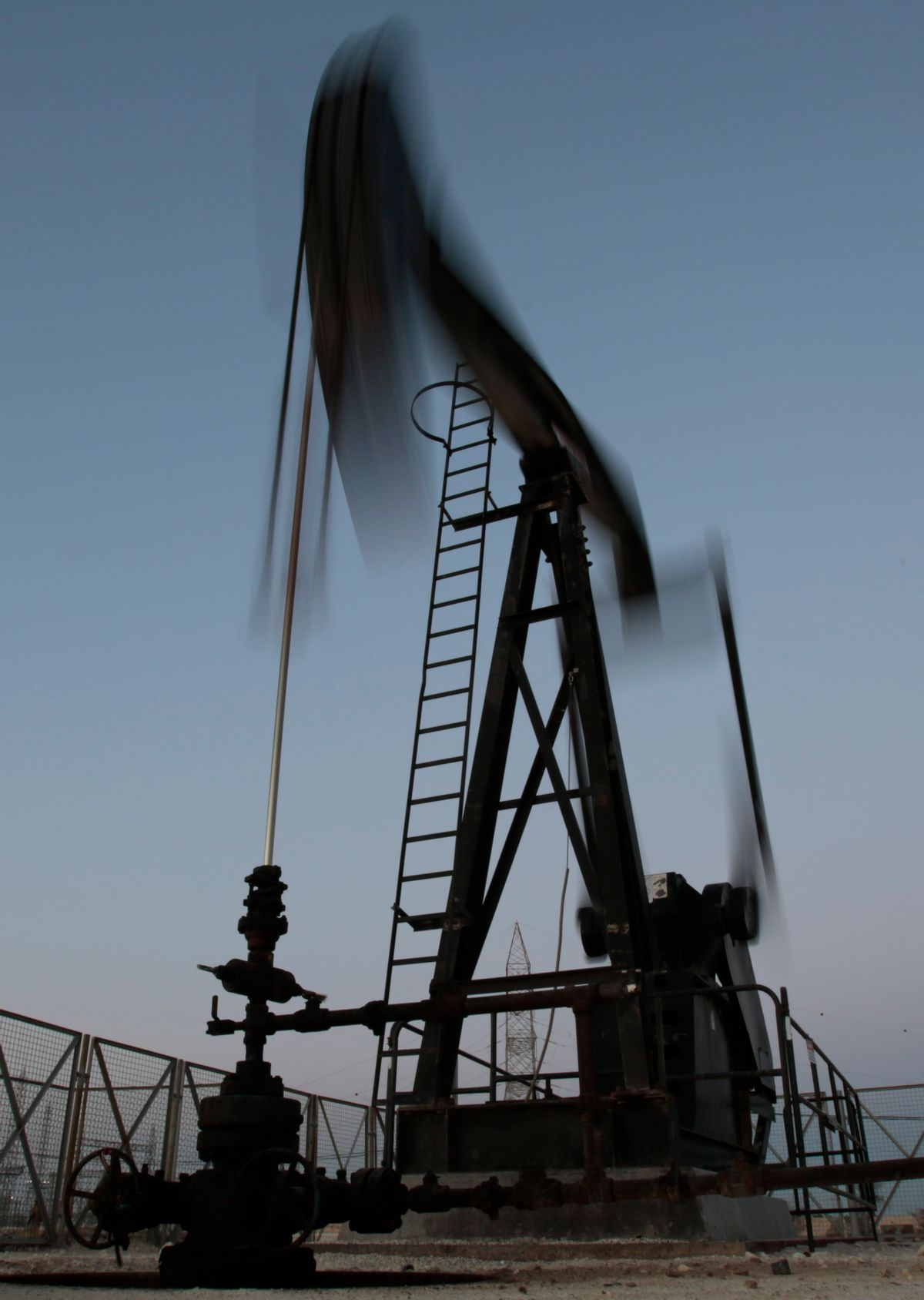 An oil pump works, on Saturday, April 16, 2016, in the desert oil fields of Sakhir, Bahrain. Oil-producing countries are to meet in Qatar on Sunday, April 17, 2016, to discuss a plan to freeze output but their gathering comes as nations like Iran rapidly ramp up their pumping. (AP Photo/Hasan Jamali) (AP)