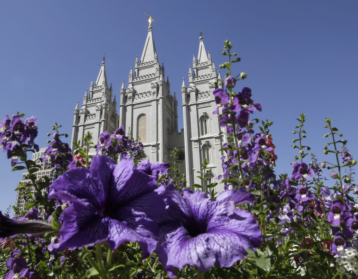 FILE - In this Sept. 3, 2014, file photo flowers bloom in front of the Salt Lake Temple, at Temple Square, in Salt Lake City.  (AP Photo/Rick Bowmer, File) (AP)