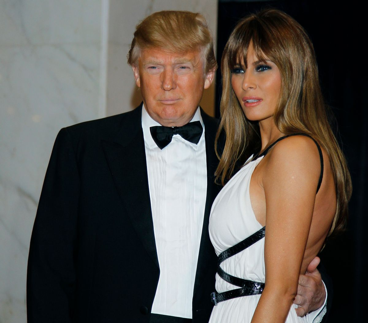 FILE - In this April 30, 2011, file photo Donald Trump, left, and Melania Trump arrive for the White House Correspondents Dinner in Washington. He won't be on November's ballot, but President Barack Obama is slowly embracing his role as the anti-Trump, taking on the Republican front-runner in ways that no other Democrat can. Obama's public scolding of Trump, who for years peddled inaccurate claims about Obama's birth certificate, dates back to 2011, when Obama roasted him at the dinner. Trump was visibly humiliated as Obama lobbed joke after joke at him on national television. (AP Photo/Alex Brandon, File) (AP)