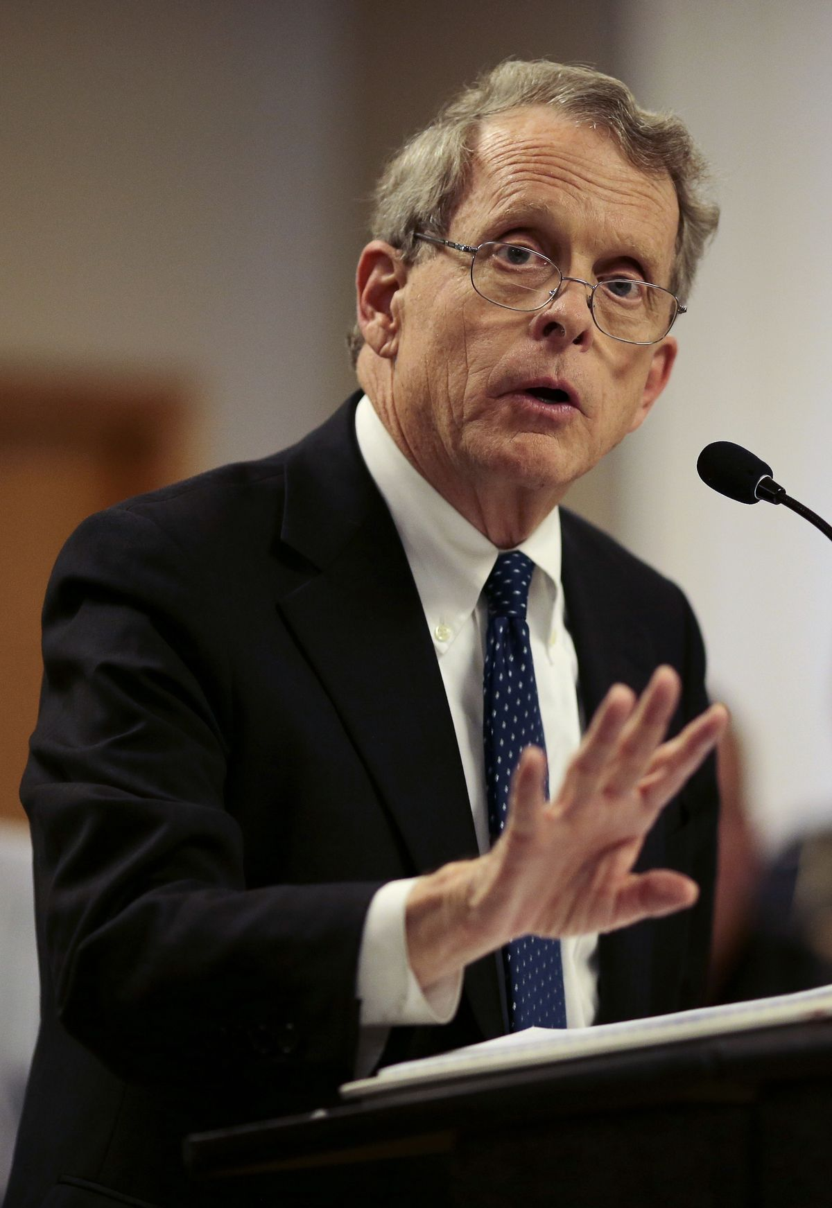 """FILE- In this April 22, 2016, file photo, Ohio State Attorney General Mike DeWine speaks during a news conference in Piketon, Ohio. Authorities are scrambling to determine who killed eight family members in a """"pre-planned execution"""" that has shaken residents of their rural southern Ohio community. DeWine on Sunday, April 24, described the killings near the small community of Piketon as """"a sophisticated operation."""" (Sam Greene/The Cincinnati Equirer via AP, File) MANDATORY CREDIT; NO SALES (AP)"""