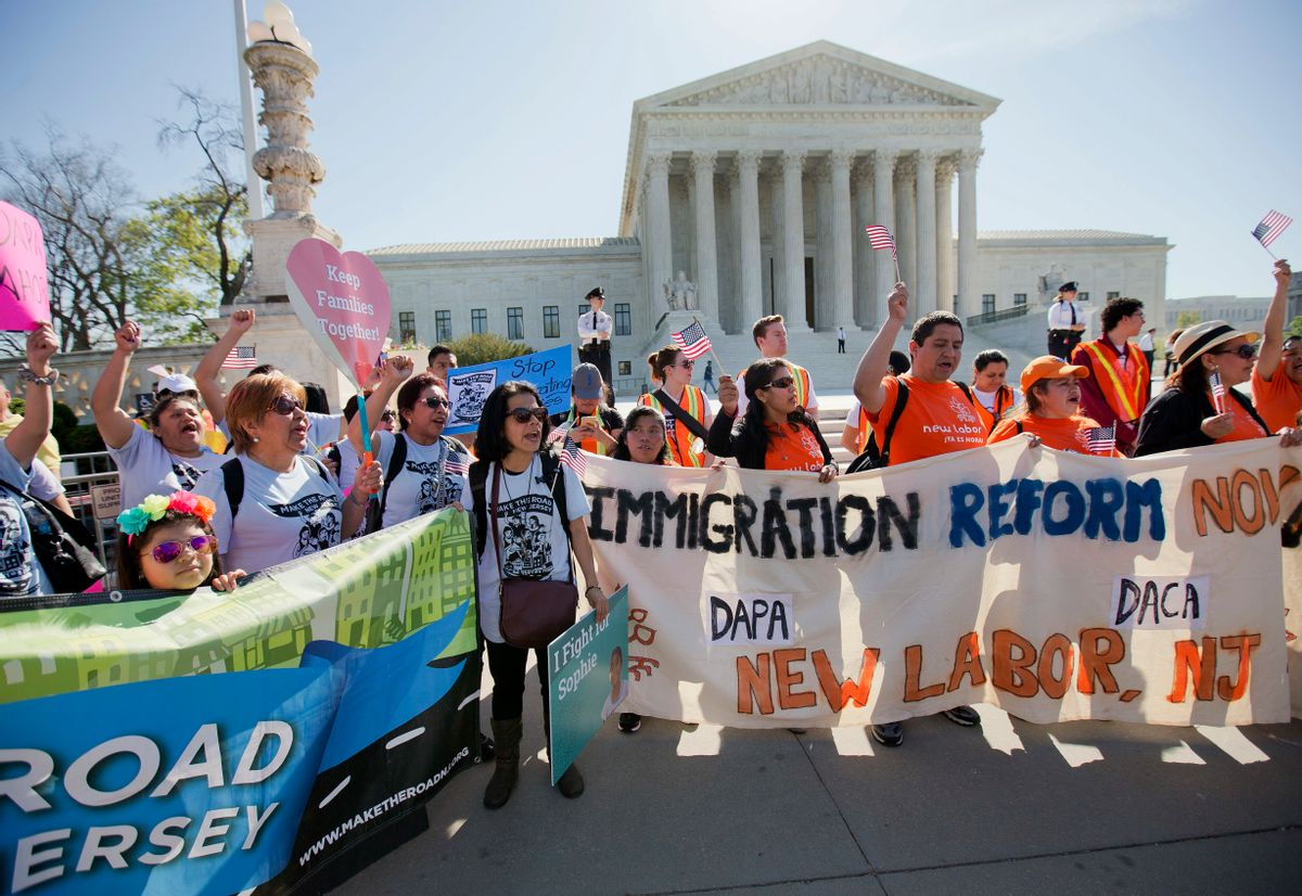 Supporters of fair immigration reform gather in front of the Supreme Court in Washington, Monday, April 18, 2016. The Supreme Court is taking up an important dispute over immigration that could affect millions of people who are living in the country illegally. The Obama administration is asking the justices in arguments today to allow it to put in place two programs that could shield roughly 4 million people from deportation and make them eligible to work in the United States. (AP Photo/Pablo Martinez Monsivais) (AP)