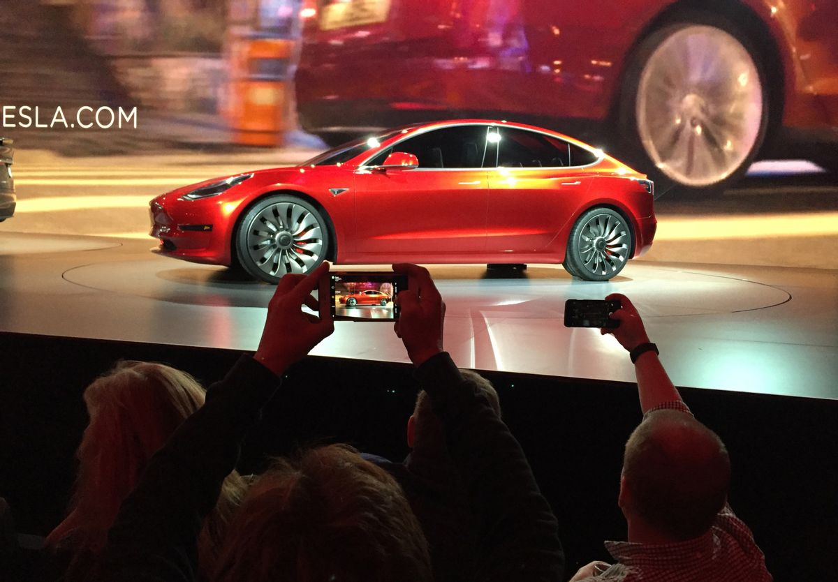 """FILE - In this March 31, 2016 file photo, Tesla Motors unveils the new lower-priced Model 3 sedan at the Tesla Motors design studio in Hawthorne, Calif. More than 276,000 people pre-order the Tesla Model 3 in less than a week. Is it the """"Tesla phenomenon,"""" or has the $35,000 electric car with a range of 200-plus miles taken finally taken the electric car to the masses. (AP Photo/Justin Pritchard) (AP)"""