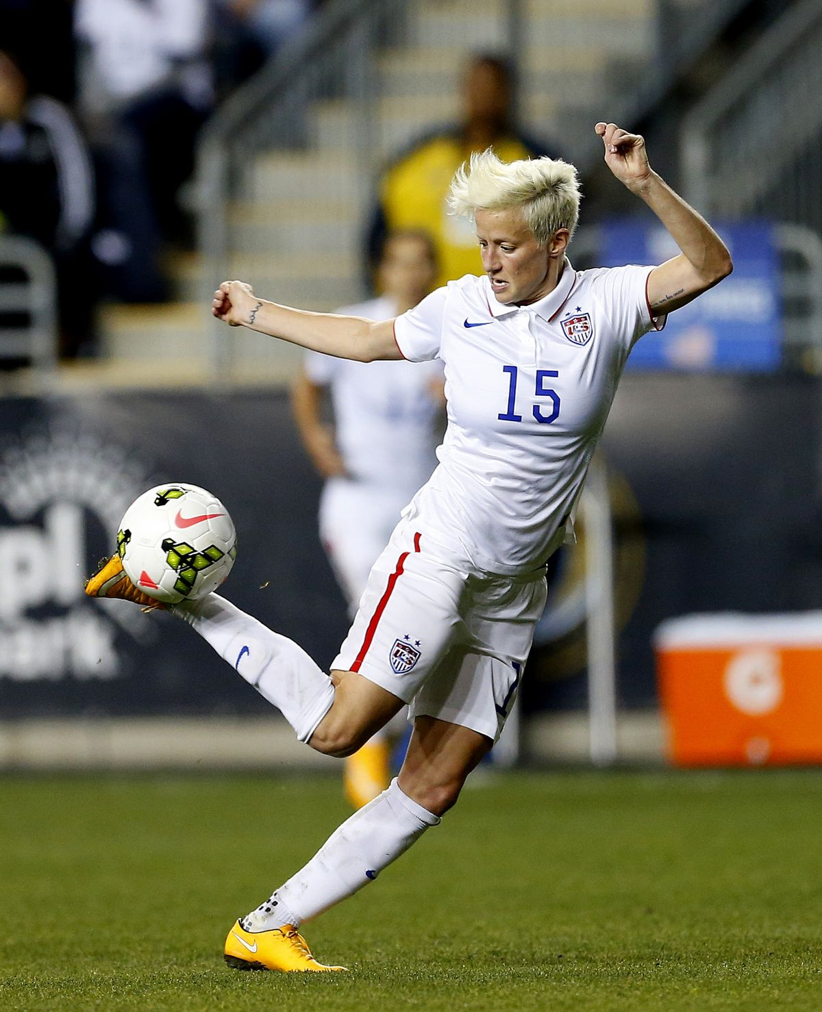 FILE - In this Oct. 24, 2014, file photo, United States midfielder Megan Rapinoe (15) against Mexico in the second half during a CONCACAF semifinal soccer match in Chester, Pa. Five players from the World Cup-winning U.S. national team have accused the U.S. Soccer Federation of wage discrimination in an action filed with the Equal Employment Opportunity Commission. Alex Morgan, Carli Lloyd, Megan Rapinoe, Becky Sauerbrunn and Hope Solo maintain in the EEOC filing they were payed nearly four times less than their male counterparts on the U.S. men's national team. The filing was announced in a press release on Thursday, March 31, 2016. (AP Photo/Rich Schultz, File) (AP)