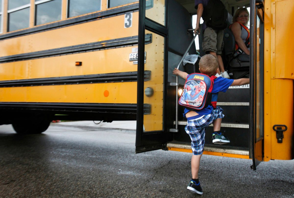 """FILE - In this Sept. 4, 2012 file photo, a student at Indian Lake Elementary in Kalamazoo, Mich., boards a bus on the first day of school. Bullying is a """"serious public health problem,"""" and should no longer be dismissed as merely a matter of kids being kids, a leading panel of experts warned Tuesday, May 10, 2016. Bullying behavior is seen as early as preschool and peaks during the middle school years, the researchers said. And the problem has morphed from the traditional bully-in-the-schoolyard scenario to newer forms of electronic aggression, such as cyberbullying on social media sites. (AP Photo/The Kalamazoo Gazette, Mark Bugnaski, File) (AP)"""
