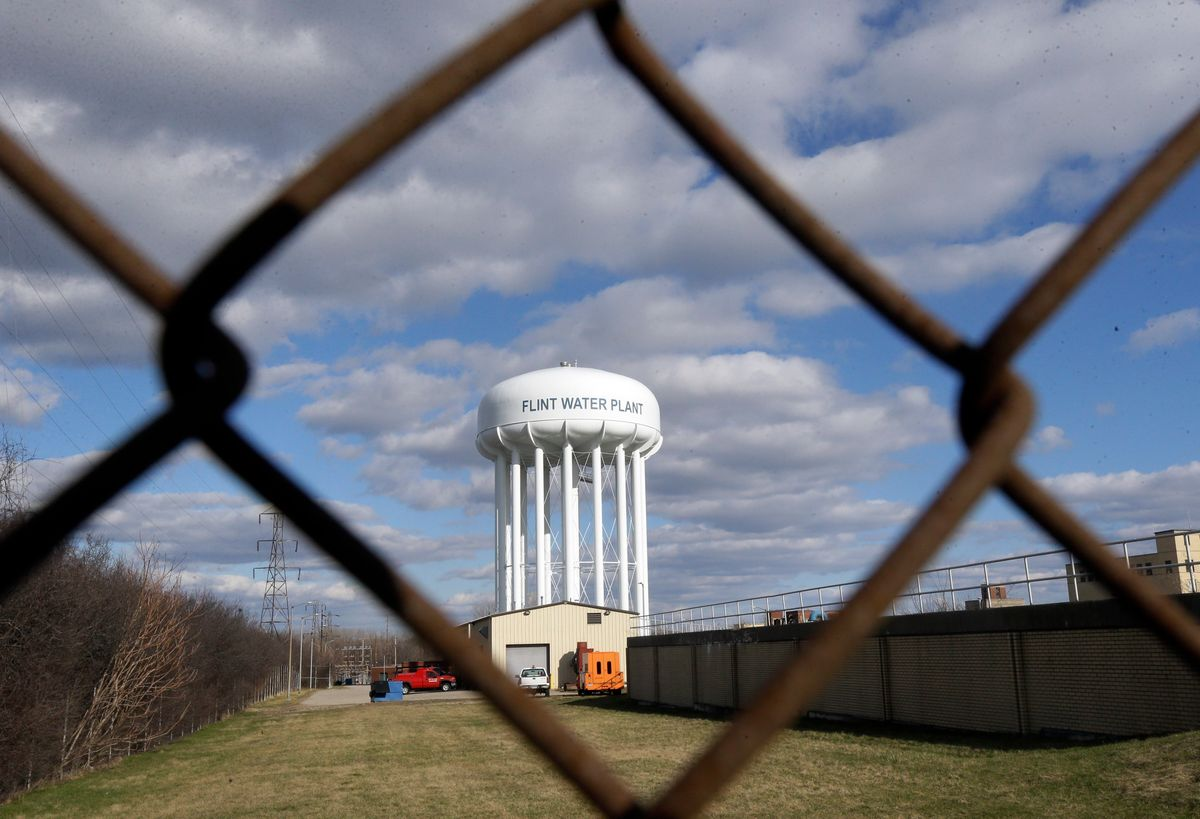 FILE - This March 21, 2016 file photo shows the Flint Water Plant water tower in Flint, Mich. Michigan Gov. Rick Snyder is calling for a halt of administrative investigations into how two state agencies dealt with the Flint drinking water crisis after being warned they are hampering state and federal criminal probes. Snyder's office released letters Thursday May 26, 2016, from the state attorney general and a federal prosecutor. (AP Photo/Carlos Osorio File) (AP)