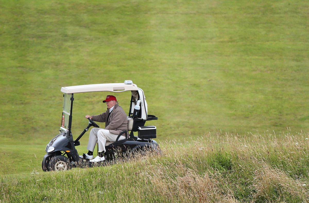 FILE - In this July 31, 2015 file photo, Republican presidential candidate Donald Trump drives his golf buggy during the second day of the Women's British Open golf championship on the Turnberry golf course in Turnberry, Scotland.  (AP)
