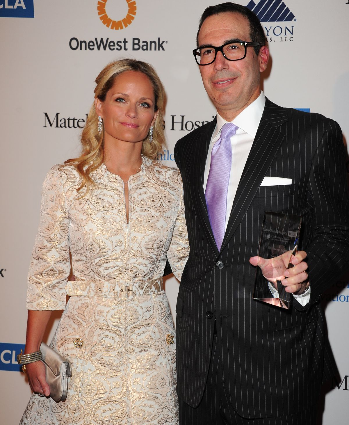 """FILE - In this April 17, 2013 file photo, Heather Mnuchin, left, and Steven Mnuchin arrive at The Kaleidoscope Ball's """"Designing The Future"""" at the Beverly Hills Hotel in Beverly Hills, Calif.  (Richard Shotwell/invision/ap)"""
