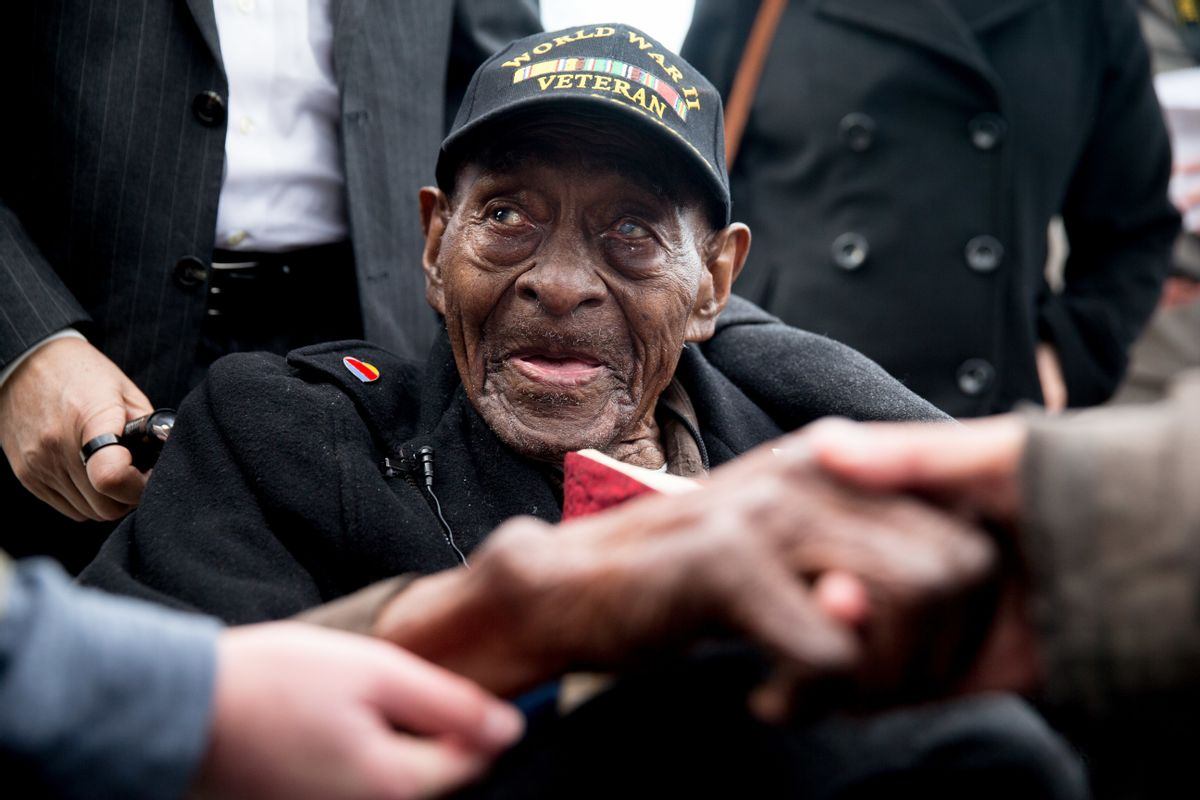 FILE - In this Dec. 7, 2015 file photo, Frank Levingston Jr., of Lake Charles, La.,  is greeted by visitors following a wreath laying ceremony to mark the anniversary of Pearl Harbor at the World War II Memorial in Washington.  Levingston, a 110-year-old veteran who served in World War II has died, on Tuesday, May 3, 2016.  () (AP Photo/Andrew Harnik)