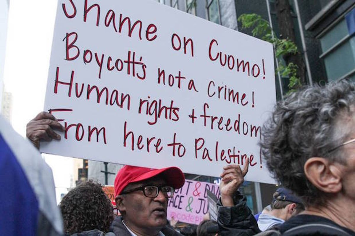 A protester at a demonstration against New York Gov. Cuomo's anti-BDS executive order, in New York City on June 9, 2016  (Jewish Voice for Peace/Jake Ratner)