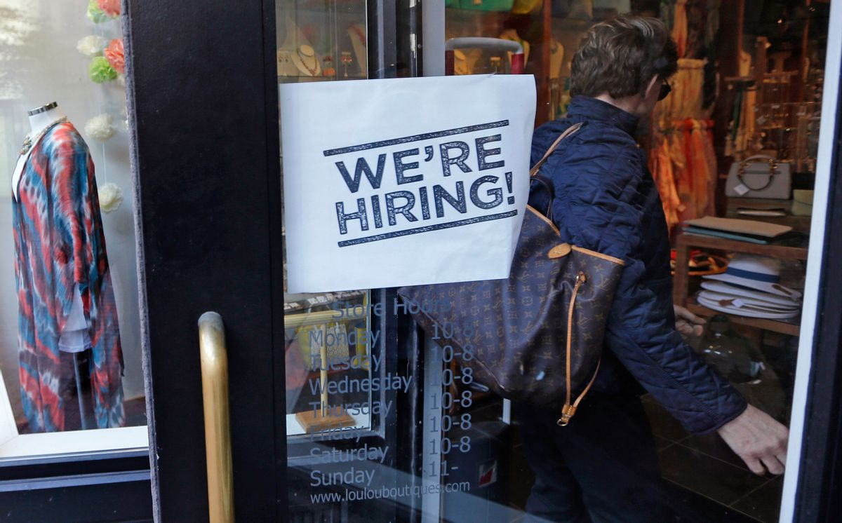 """FILE - In this Wednesday, May 18, 2016, file photo, a woman passes a """"We're Hiring!"""" sign while entering a clothing store in the Downtown Crossing of Boston. On Friday, June 3, 2016, the U.S. government issues the May jobs report. (AP Photo/Charles Krupa, File) (AP)"""