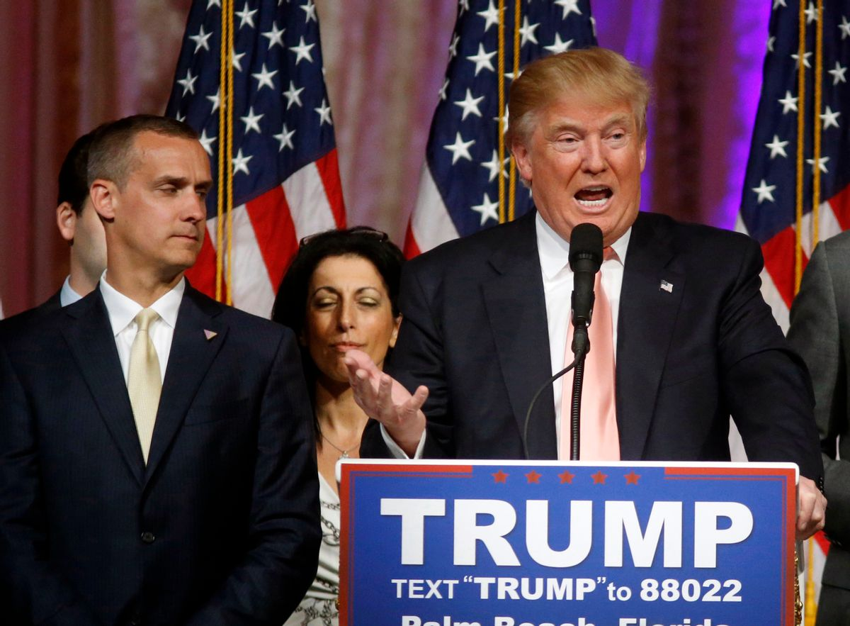 FILE - -In this March 15, 2016 file photo, Donald Trump's campaign manager Corey Lewandowski listens at left are Trump speaks in Palm Beach, Fla. Trump has forced out his hard-charging campaign manager, Lewandowski, in a dramatic shakeup designed to calm panicked Republican leaders and reverse one of the most tumultuous stretches of Trump's unconventional White House bid.  (AP Photo/Gerald Herbert, File) (AP)