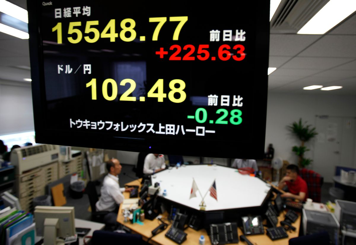 Currency dealers wait for clients' orders under an electronic board showing Nikkei stock index, top, and the exchange rate between US dollars and Japanese yen, bottom, at Ueda Harlow, a foreign exchange trading company in Tokyo Wednesday, June 29, 2016. Asian stock markets rallied on Wednesday following overnight gains on Wall Street and even bigger gains in Europe, as worries about stepping into the era of uncertainty following Britain's referendum eased. (AP Photo/Shuji Kajiyama) (AP)