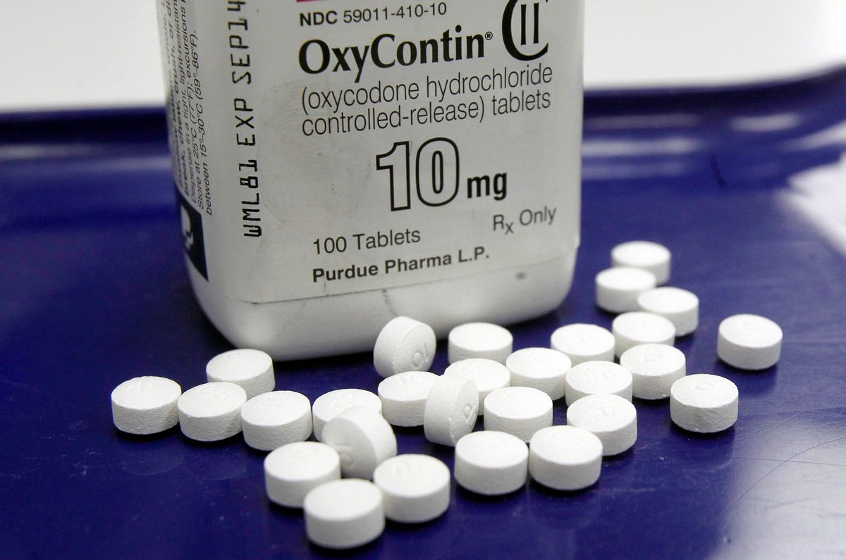 FILE - This Feb. 19, 2013, file photo, shows OxyContin pills arranged for a photo at a pharmacy in Montpelier, Vt. Overdoses don't happen just to heroin addicts _ patients who legally use strong painkillers called opioids are at risk in the nation's epidemic, too. A new study says when patients were prescribed an overdose antidote along with those medications, they made fewer painkiller-related visits to the emergency room. The study released on June 27, 2016, went a step further _ to see if the take-home antidote idea also could work for patients with chronic pain who may not realize they could accidentally get into trouble with prescription painkillers such as Oxycontin, Vicodin and others. (AP Photo/Toby Talbot, File) (AP)