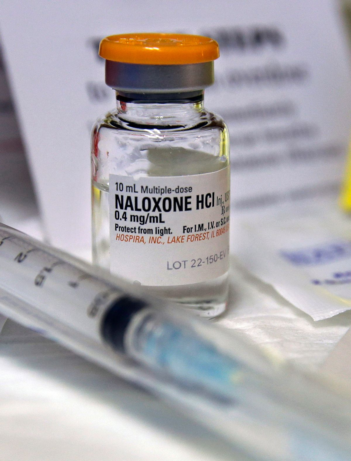 FILE- In this Wednesday, Feb. 19, 2014, file photograph, a small bottle of the opiate overdose treatment drug, naloxone, also known by its brand name Narcan, is displayed at the South Jersey AIDS Alliance in Atlantic City, N.J. It is becoming easier for friends and family of heroin users or patients abusing strong prescription painkillers to get access to naloxone, a powerful, life-saving antidote, as state lawmakers loosen restrictions on the medicine to fight a growing epidemic. (AP Photo/Mel Evans, File) (AP)