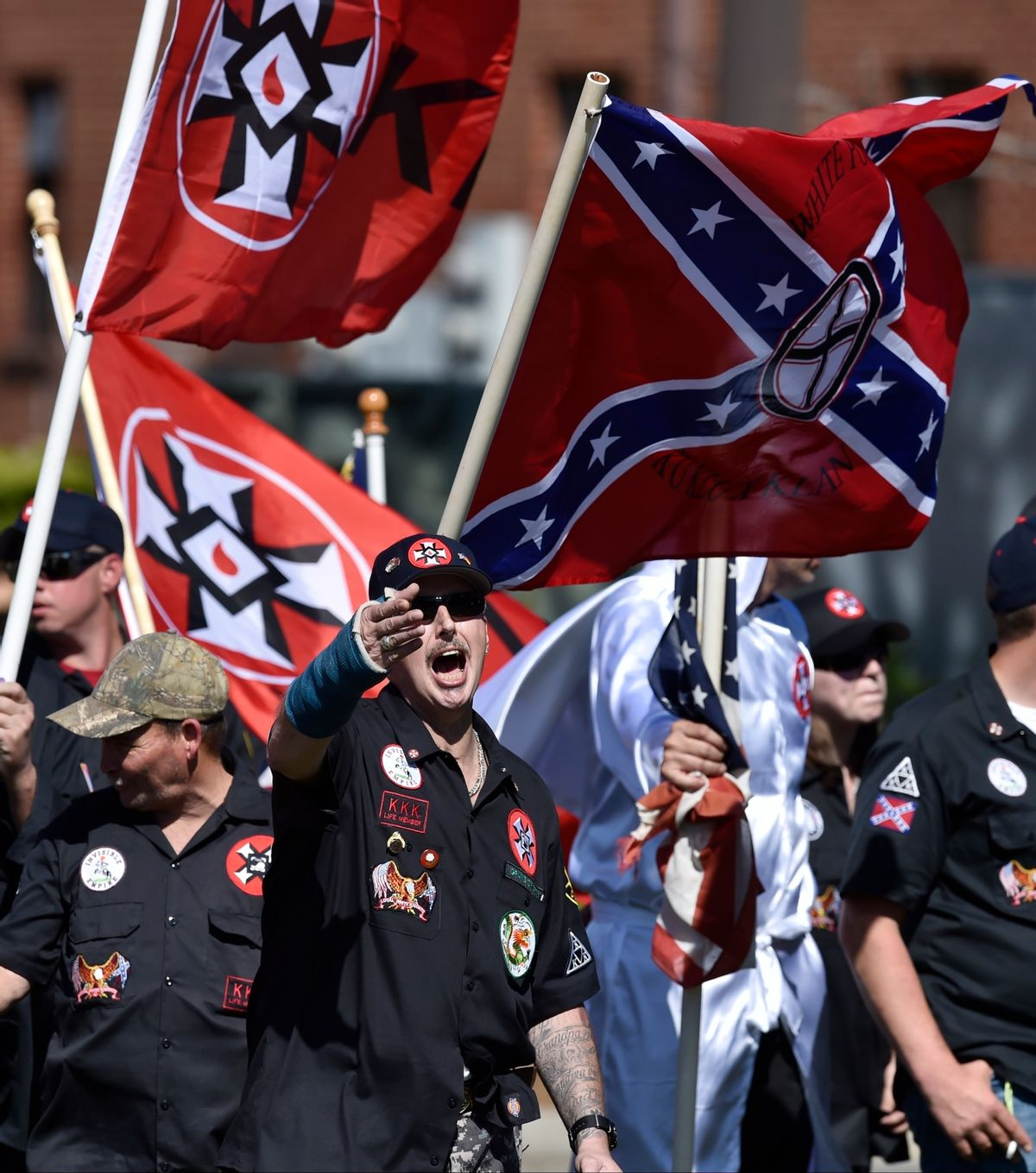 """In this Saturday, April 23, 2016 photo, Loyal White Knights Grand Dragon Will Quigg of Anaheim, Calif., center, shouts to protestors during a """"White Pride,"""" rally, in Rome, Ga.  (AP)"""