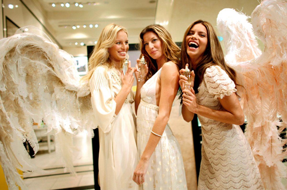 Victoria's Secret models Karolina Kurkova, Gisele Bundchen and Adriana Lima.   (AP/Jason DeCrow)
