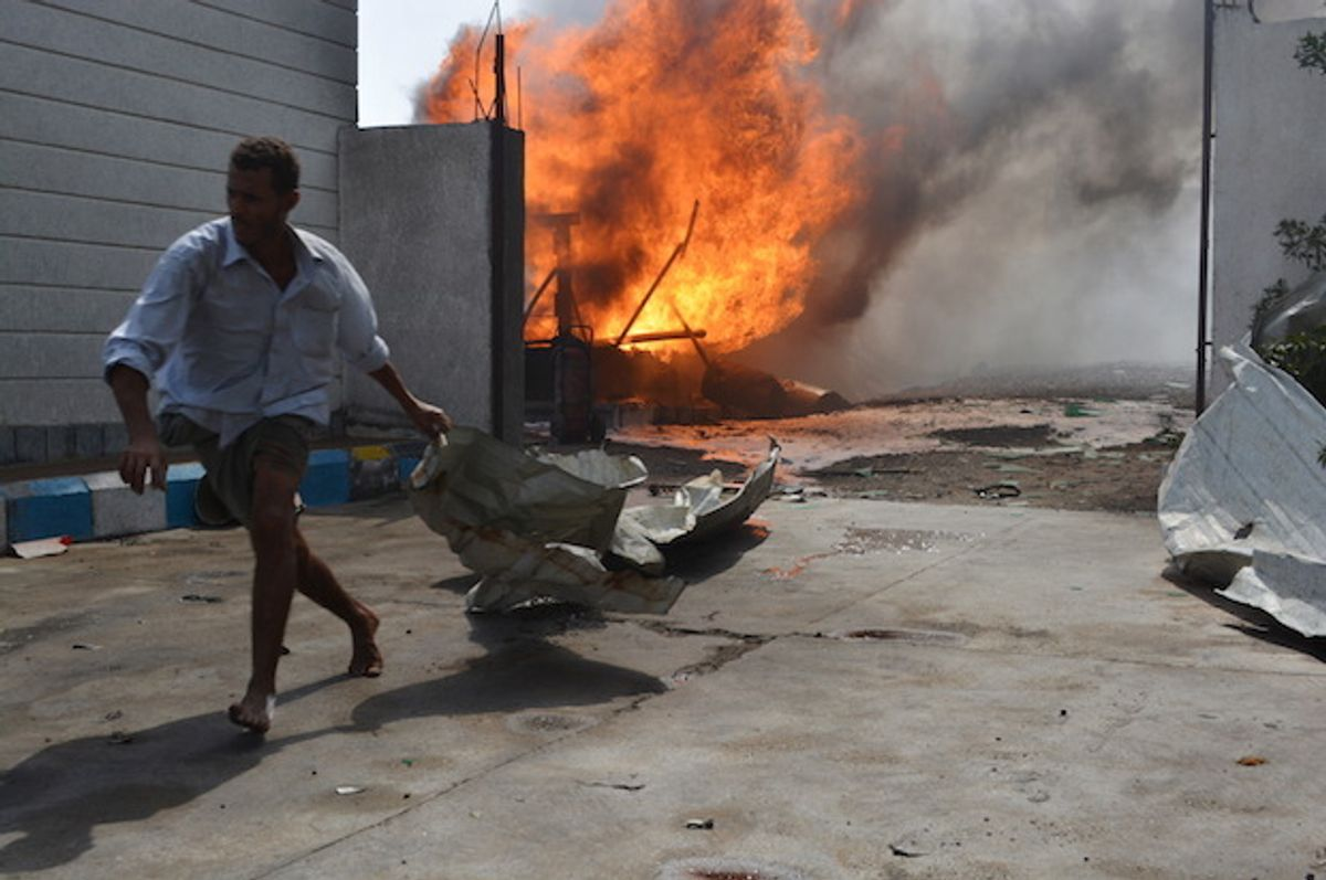 A Yemeni man flees a gas station after it was hit by a Saudi-led coalition airstrike in Houdieda, Yemen on February 5, 2016  (Reuters/Abduljabbar Zeyad)