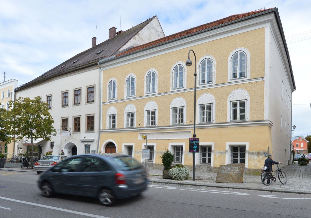 FILE - This Sept. 27, 2012 file picture shows an exterior view of Adolf Hitler's birth house , front, in Braunau am Inn, Austria.   Austria's Interior Ministry says the government has drawn up a draft law that would dispossess the owner of the house where Adolf Hitler was born. Tuesday's July 12, 2016  move follows steadfast refusal by house owner Gerlinde Pommer to sell the empty building in the town of Braunau am Inn on the German border. The government has sought ownership so it can take measures to lessen its attraction as a shrine for the Nazi dictator's admirers.  (AP Photo / Kerstin Joensson,file) (AP)