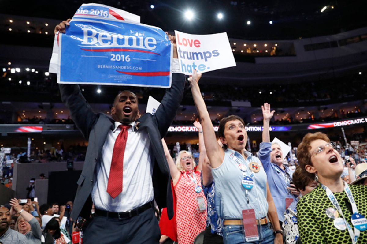 A supporter of Bernie Sanders approaches the podium at the Democratic National Convention in Philadelphia, July 25, 2016.   (Reuters/Mark Kauzlarich)