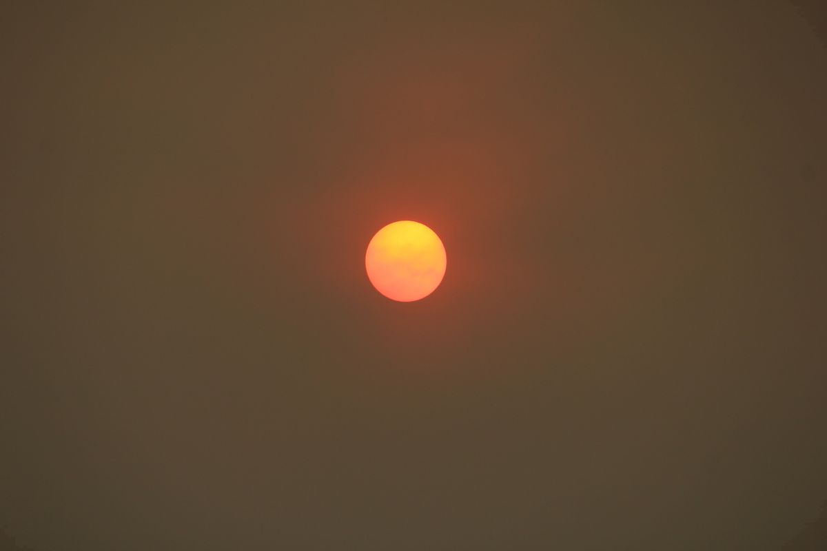 The morning sun over Pasadena, Calif., is reduced to an orange disk by smoke from a wildfire burning north of Los Angeles on Saturday, July 23, 2016. The fire erupted Friday afternoon amid a withering heat wave and spread over thousands of acres while sending up a plume of smoke that spread widely and dropped ash across the region. (AP Photo/John Antczak) (AP)