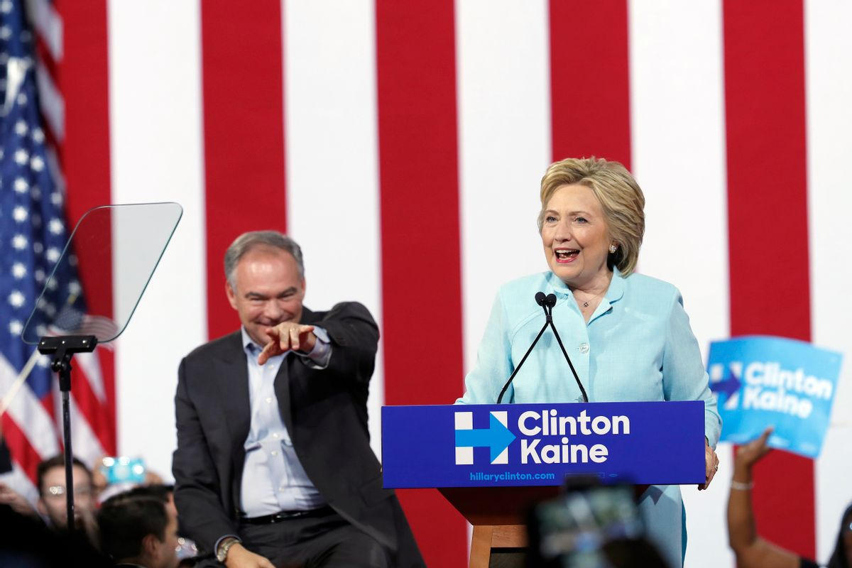 FILE - In this July 23, 2016 file photo, Democratic presidential candidate Hillary Clinton, accompanied by her running mate, Democratic Vice Presidential candidate Sen. Tim Kaine, D-Va., speaks at a rally in Miami. The Democratic National Convention speaker's lineup has highlighted an increasingly diverse country that could soon elect the first female president as successor to its first black chief executive.  (AP Photo/Mary Altaffer, File) (AP)