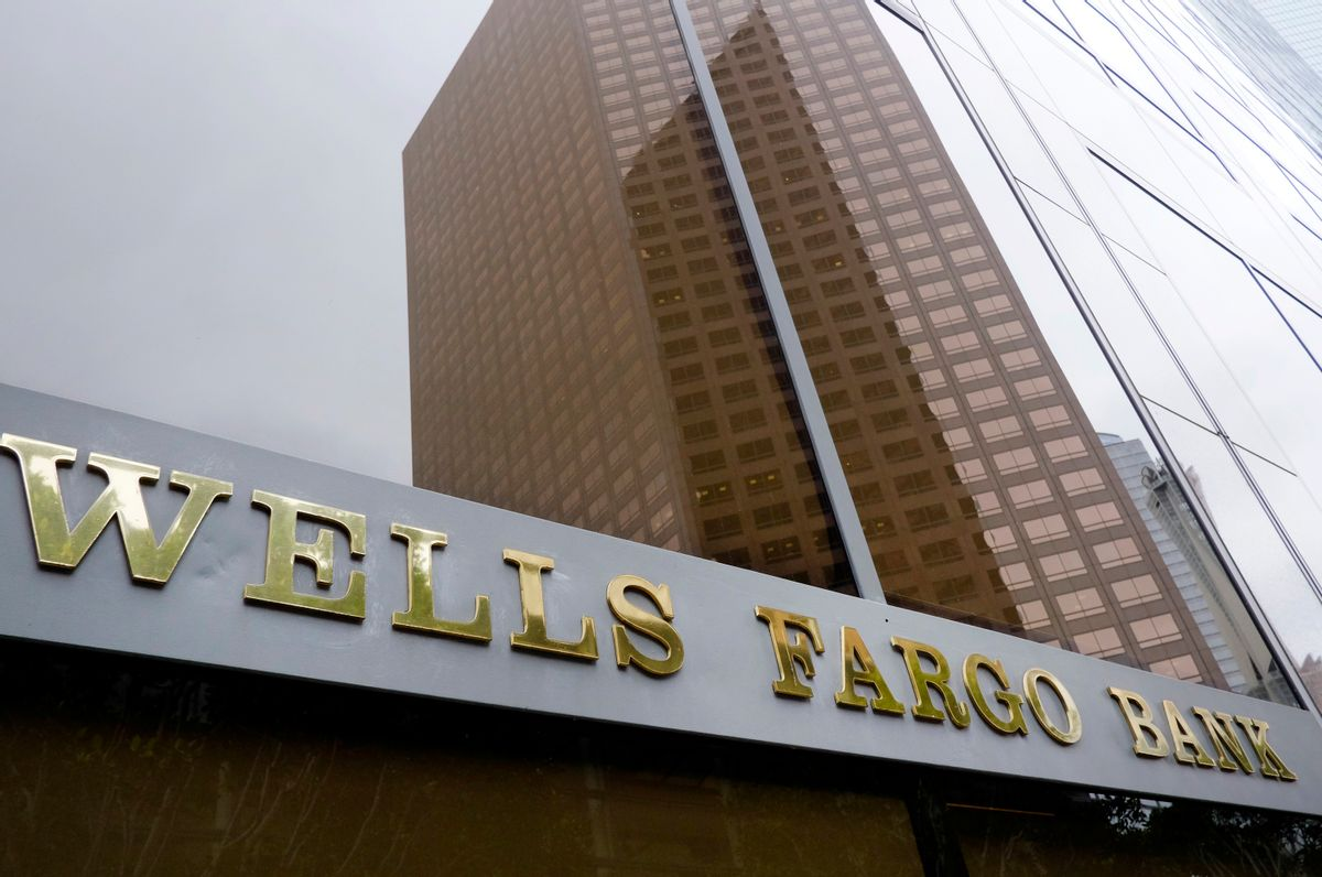 FILE - In this May 5, 2015, file photo, a downtown building is reflected in the windows of a Wells Fargo Bank in Los Angeles. Wells Fargo reports financial results on Friday, July 15, 2016. (AP Photo/Richard Vogel, File) (AP)