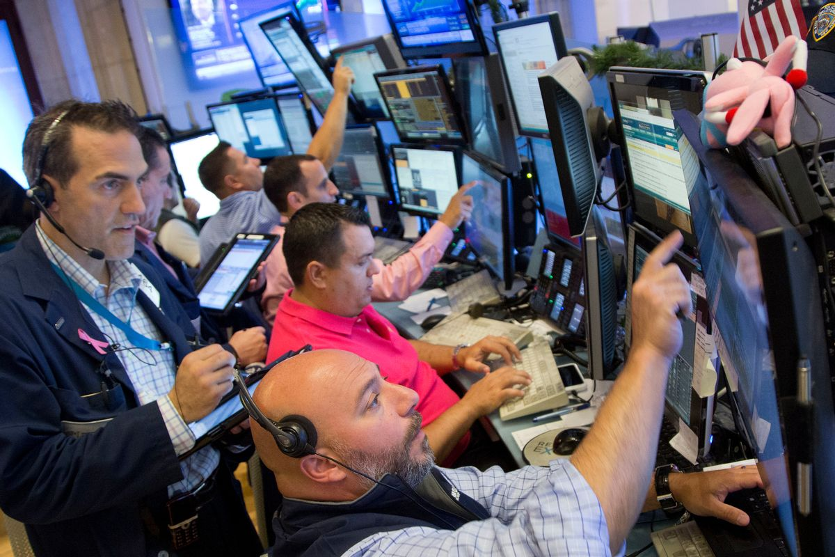 Greg Rowe, left, and Vincent Napolitano, bottom, with Livermore Trading Group, monitor stock prices at the New York Stock Exchange, Friday, July 22, 2016. (AP Photo/Mark Lennihan) (AP)