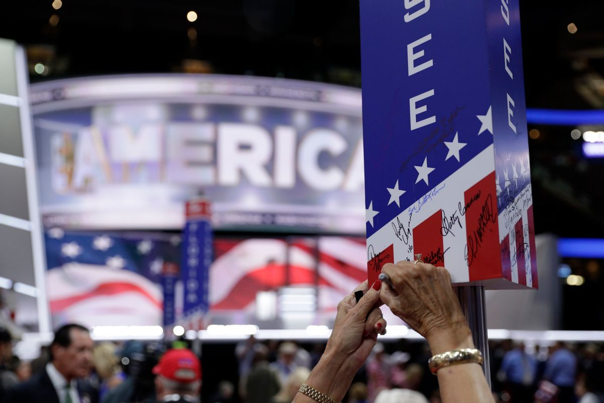 A Tennessee delegate signs on the post before the final day of the Republican National Convention in Cleveland, Thursday, July 21, 2016. (AP Photo/John Locher) (AP)