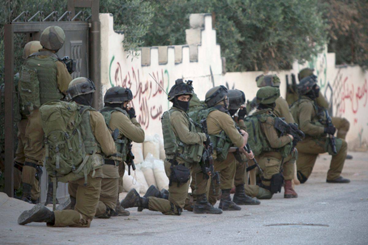 Israeli troops deploy during an army operation at West Bank village of Salem, May 30, 2016.   (AP/Majdi Mohammed)