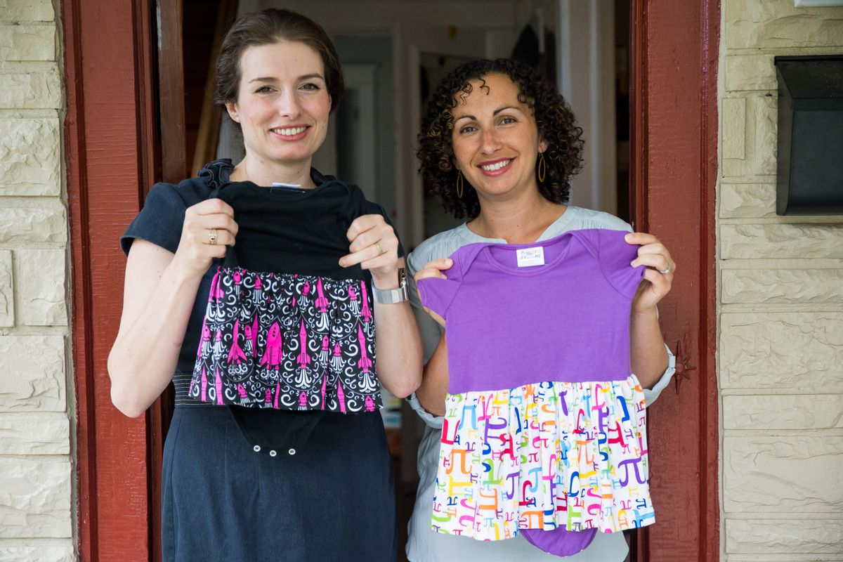 In this Tuesday, July 19, 2016, photo, Eva St. Clair, left, and Rebecca Melsky pose for a portrait at Melsky's home in Washington. Melsky and St. Clair design dresses for Princess Awesome, a girls' clothing line that uses traditional boys' motifs such as trains, dinosaurs, ninjas, and planes. (AP Photo/Zach Gibson) (AP)