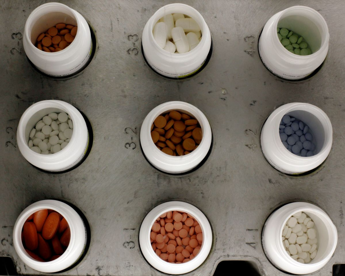 FILE - In this June 14, 2011 file photo, various prescription drugs on the automated pharmacy assembly line at Medco Health Solutions in Willingboro, N.J. (AP Photo/Matt Rourke, File) (AP)