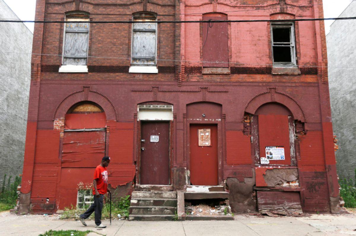 A man walks through a blighted neighborhood, July 11, 2013, in Philadelphia.   (AP/Matt Rourke)