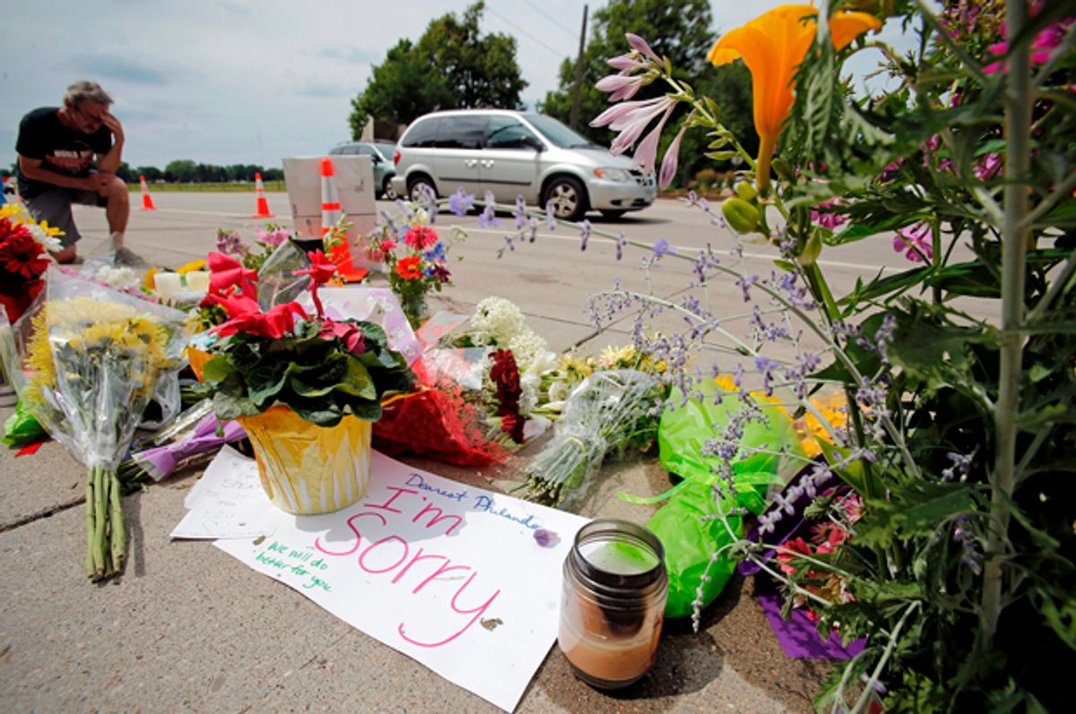 A memorial at the site of the police shooting of Philando Castile in Falcon Heights, Minnesota, July 7, 2016.   (Reuters/Eric Miller)