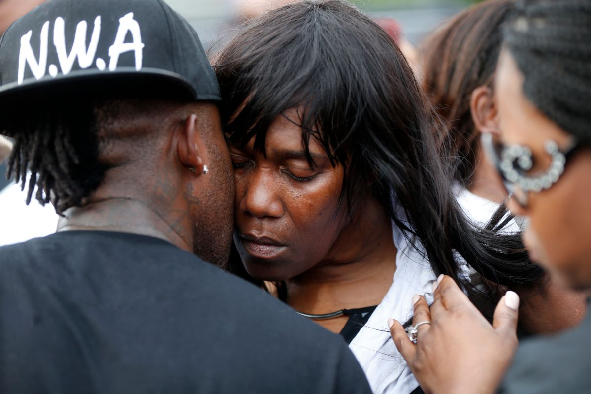 Sandra Sterling, aunt of Alton Sterling, is comforted at a vigil outside the Triple S convenience store in Baton Rouge, La., Wednesday, July 6, 2016. Sterling, 37, was shot and killed outside the store by Baton Rouge police, where he was selling CDs. (AP Photo/Gerald Herbert) (AP)