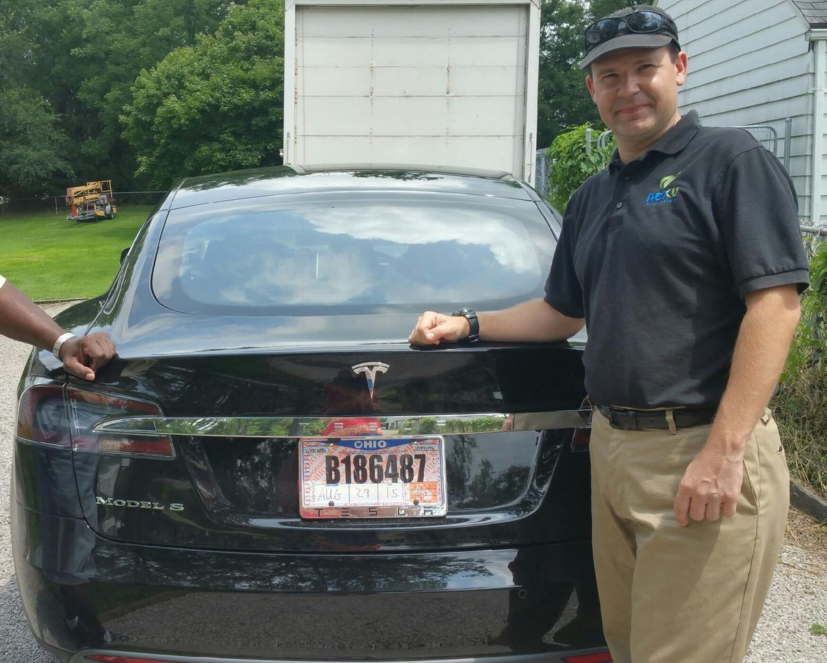 In this 2015 photo provided by his neighbor, Krista Kitchen, Joshua Brown stands by his new Tesla electric car near his home in Canton, Ohio. Brown died in an accident in Florida on May 7, 2016 in the first fatality from a car using self-driving technology. According to statements by the government and the automaker, his vehicle's cameras didn't make a distinction between the white side of a turning tractor-trailer and the brightly lit sky while failing to automatically activate its brakes. (Krista Kitchen via AP) (AP)