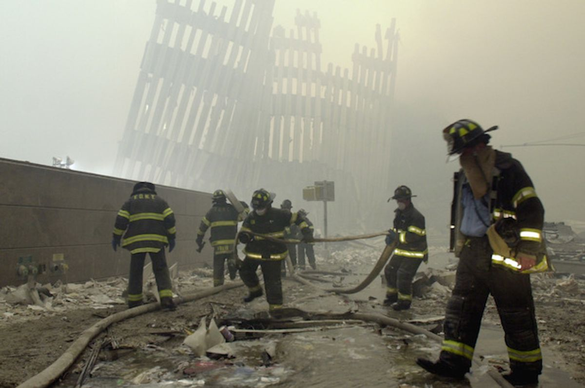 Firefighters at the World Trade Center, after the attacks on Sept. 11, 2001  (AP/Mark Lennihan)