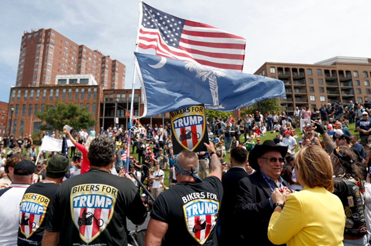 Members of the group Bikers for Trump watch during a rally for Donald Trump at Settlers Landing Park, July 18, 2016, in Cleveland.   (AP/John Minchillo)