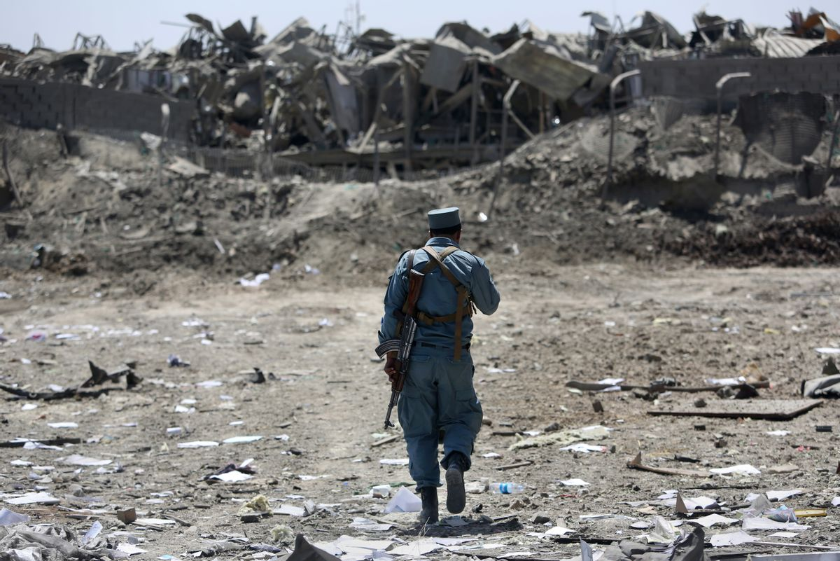 FILE - In this Monday, Aug. 1, 2016 file photo, an Afghan Security policeman inspects the site of a suicide truck bombing, in Kabul, Afghanistan.  (AP)