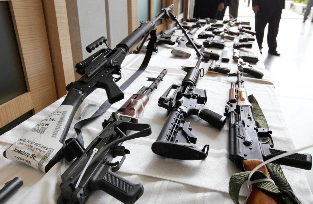 FILE - In this July 22, 2010, file photo, various guns are displayed at the Chicago FBI office. A new poll shows most young adults across racial and ethnic groups support tighter gun polices including background checks, stricter penalties for gun law violations, and banning semi-automatic weapons. In the new GenForward poll, about 9 in 10 young adults say they support criminal background checks for all gun sales, a level of support that remains consistent across racial and ethnic groups.(AP Photo/M. Spencer Green, File) (AP)