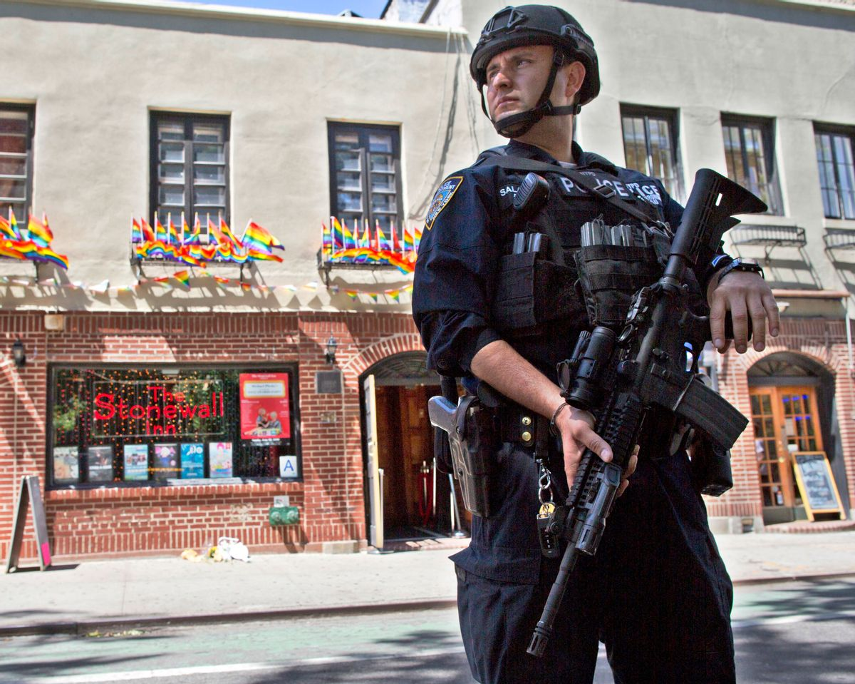 FILE - In this June 12, 2016 file photo, an armed police officer stands guard outside the Stonewall Inn, in New York after a Florida gunman's attack at a gay nightclub spread fear of more attacks. The officer is heavily armed and equipped, in a manner typical of the NYPD's counterterrorism unit and Emergency Service Unit - the NYPD's equivalent of SWAT officers. But the NYPD plans to distribute 20,000 helmets and 6,000 vests before the end of the year to uniformed patrol officers to protect them better during combat with rampaging shooters (AP Photo/Mary Altaffer, File) (AP)