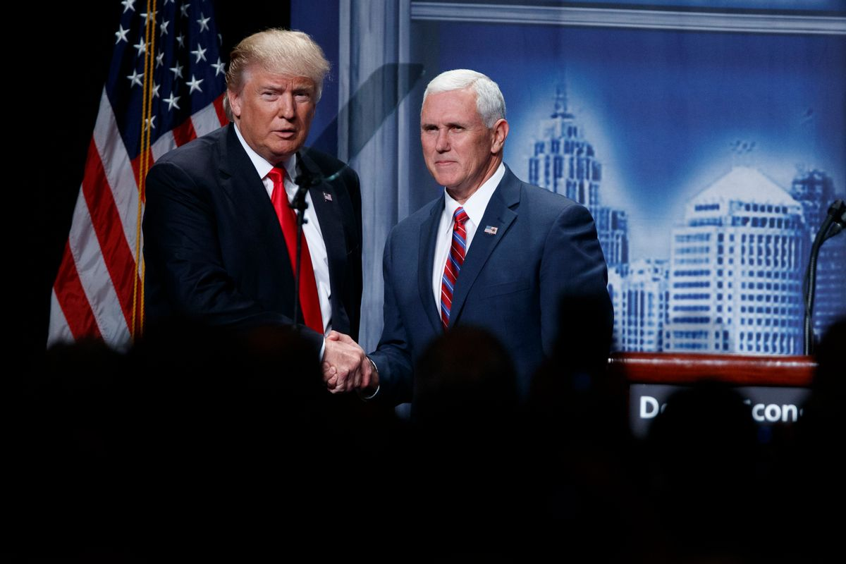 FILE- In this Aug. 8, 2016, file photo, Republican presidential candidate Donald Trump shakes hands with his running mate, Republican vice presidential candidate, Indiana Gov. Mike Pence as he arrives to give an economic policy speech to the Detroit Economic Club in Detroit. A campaign official familiar with the plans said Thursday, Aug. 18, that the GOP nominee and his running mate will tour the flood damage in ravaged Louisiana on Friday. (AP Photo/Evan Vucci, File) (AP)