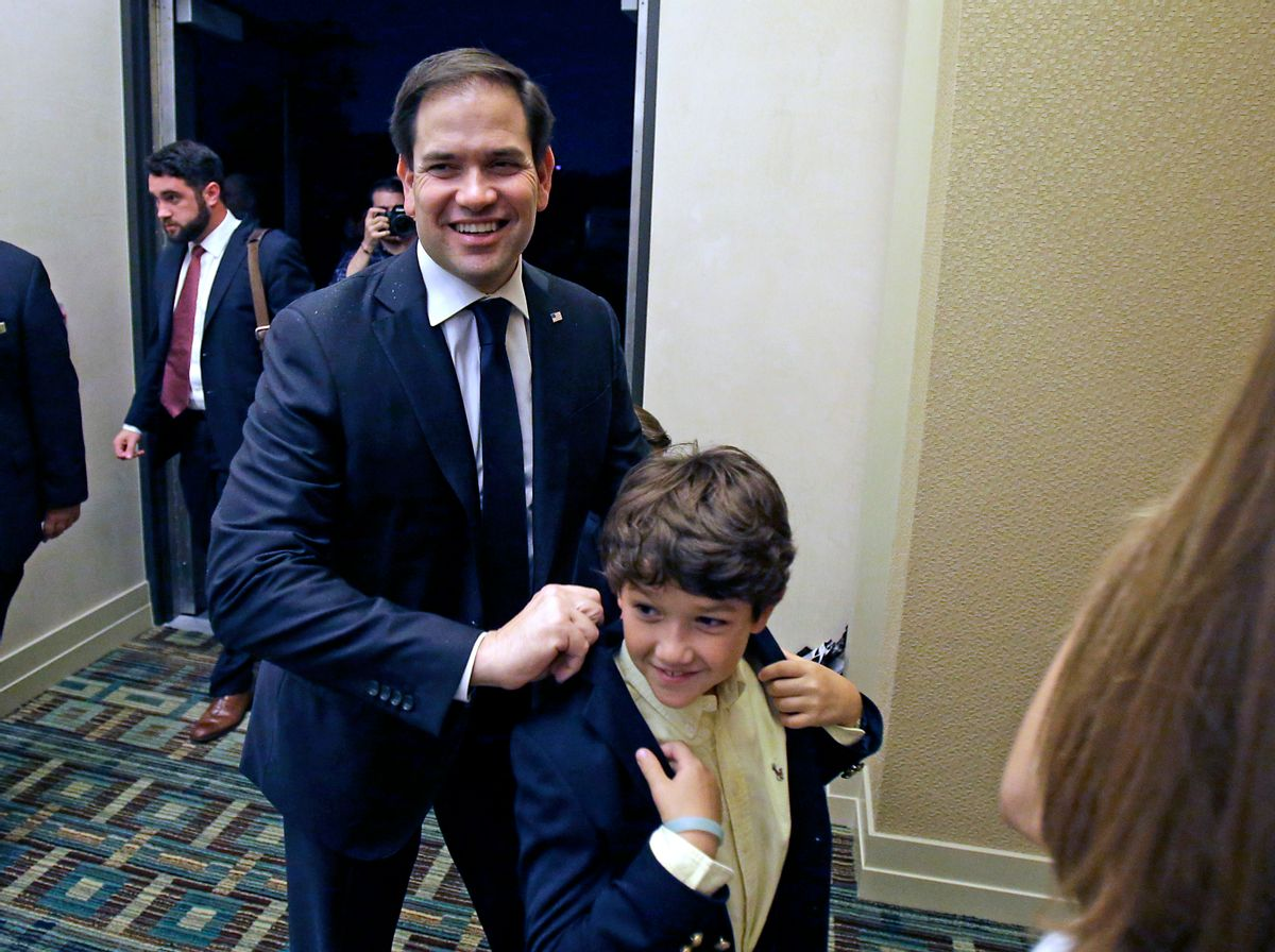 Sen. Marco Rubio, R-Fla., arrives with members of his family to a primary election party, Tuesday, Aug. 30, 2016, in Kissimmee, Fla. (AP)