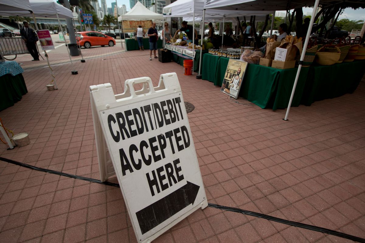 FILE - In this June 8, 2015, file photo, credit card customers are directed to a pay station at the green market in downtown Miami. On Friday, Aug. 5, 2016, the Federal Reserve releases its June report on consumer borrowing. (AP Photo/J Pat Carter, File) (AP)