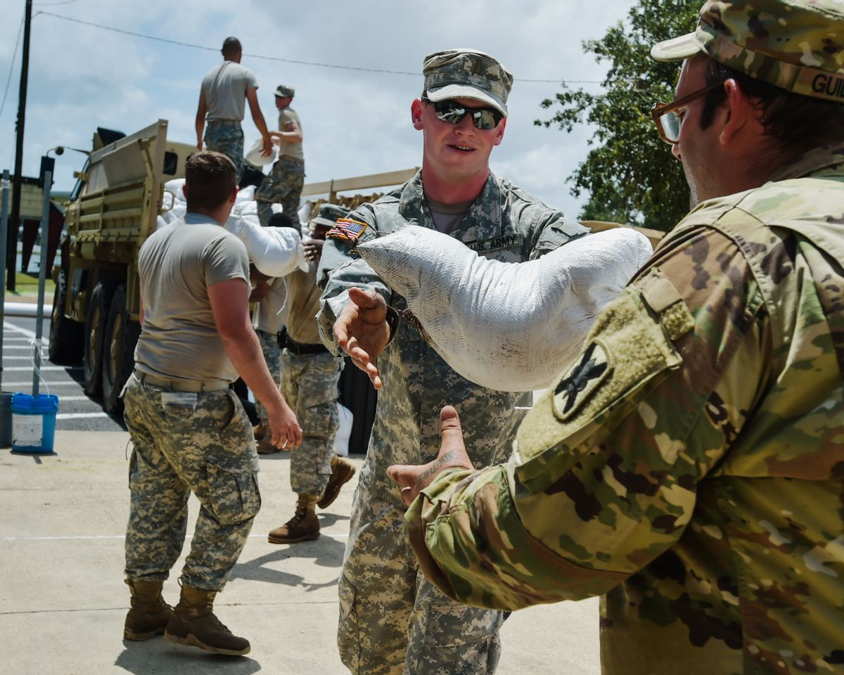 Second Lt. Dakota Jude and Army National Guard members help place sandbags to protect the city hall in Lake Arthur, La., Wednesday, Aug. 17, 2016. (Scott Clause/The Daily Advertiser via AP) (AP)