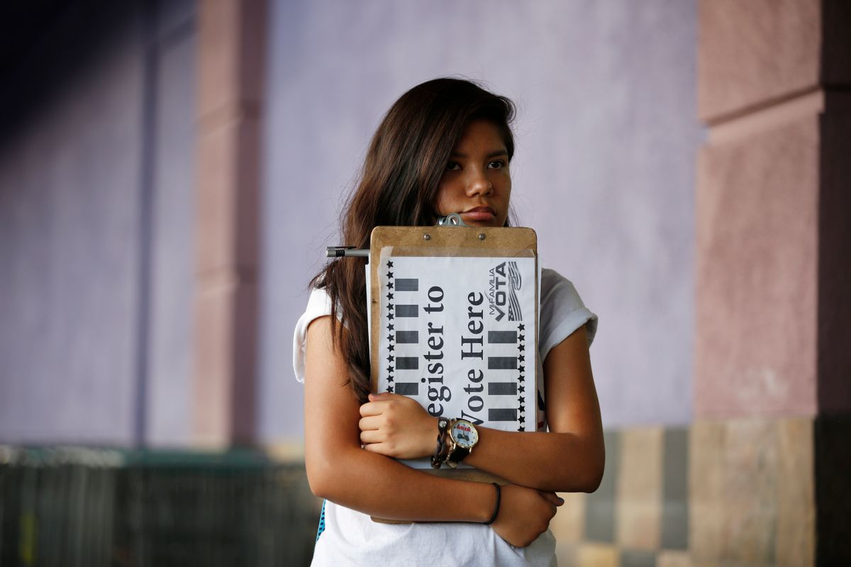 """Fabiola Vejar waits to register people to vote in front of a Latino supermarket in Las Vegas on Thursday, June 9, 2016. Shielded from deportation under an Obama administration program that protects those brought to the country illegally as children, Vejar, 18, cannot vote. So she volunteers with Mi Familia Vota, encouraging others to be heard at the ballot box. """"I don't have that voice,"""" she says, """"but there's other people ... who feel the way I do. They should vote."""" (AP Photo/John Locher) (AP)"""